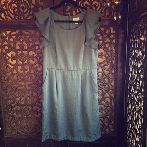 Teal blue silk dress with pockets. Mid-length.